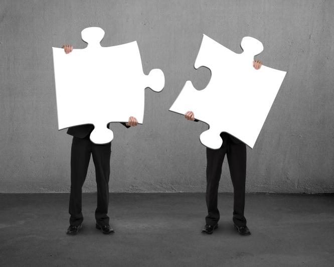 2 people puzzle pieces_AdobeStock_63895982.jpeg